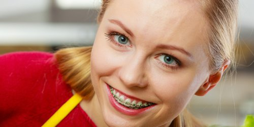 a woman using braces smiling