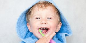 cute baby brushing teeth