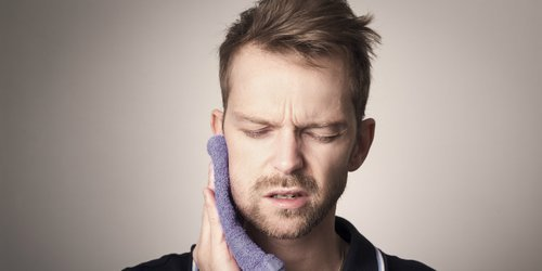 a person is experiencing thrush in the mouth