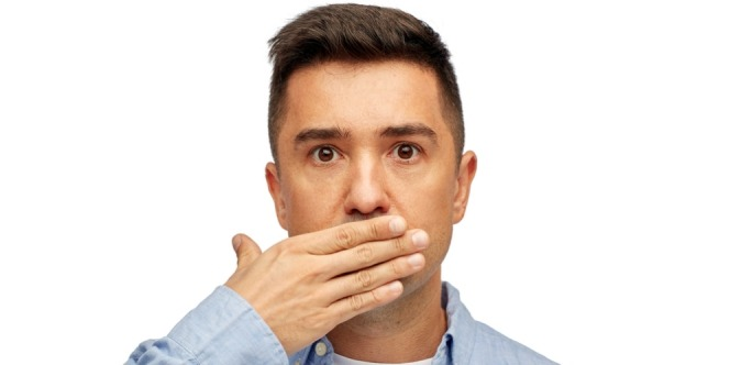 a man is closing his mouth