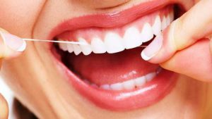 brush between your teeth with a rope