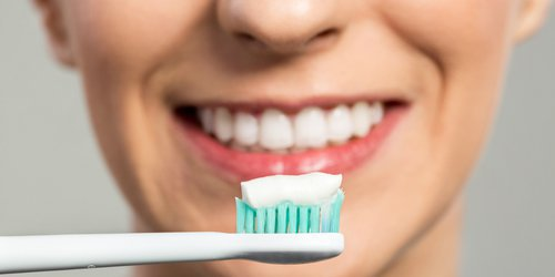 picture of woman ready to brush her teeth