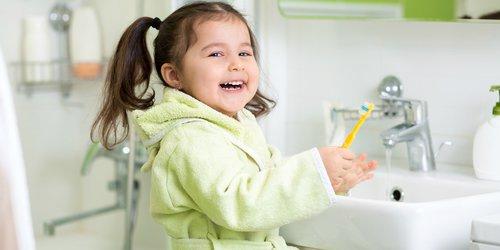 Daughter smiling after brushing her teeth