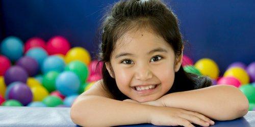 girls smile with healthy milk teeth