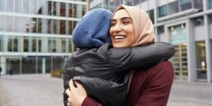 a woman is hugging her friend